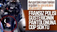 Fransız polisi göstericiyi copla taciz etti