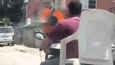 Şok görüntü! Sıcaktan bunalan sürücü, motosikletin önüne pervane taktı