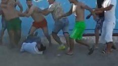 Antalya'da sahilde eşini döven kişi darbedildi