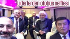 Putin ve Ruhani'den otobüste selfie