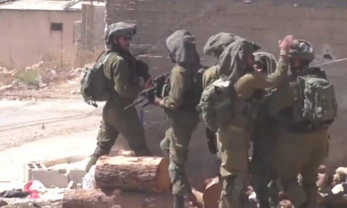 Taştan korkan İsrail askerleri komutandan dayak yedi