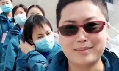 Çin'de doktorlar maskelerini çıkardı