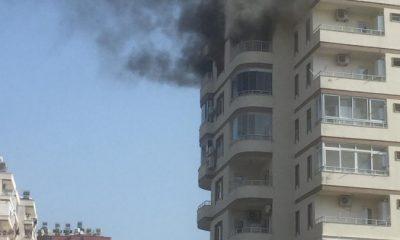 Yangın çıkan evinin balkonundan düşen kadın can verdi