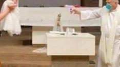 Rahipten su tabancasıyla vaftiz